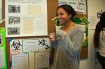 Christina Lopez stands by her poster on the environmental and health impacts of medical waste.